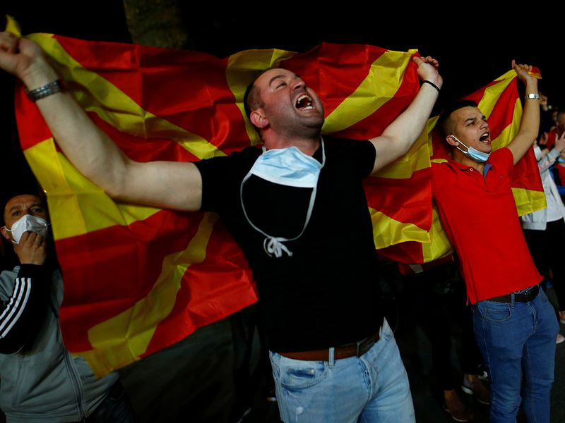 Supporters of North Macedonia celebrate their teams 2-1 victory over Germany outside the Duisburg stadium.
