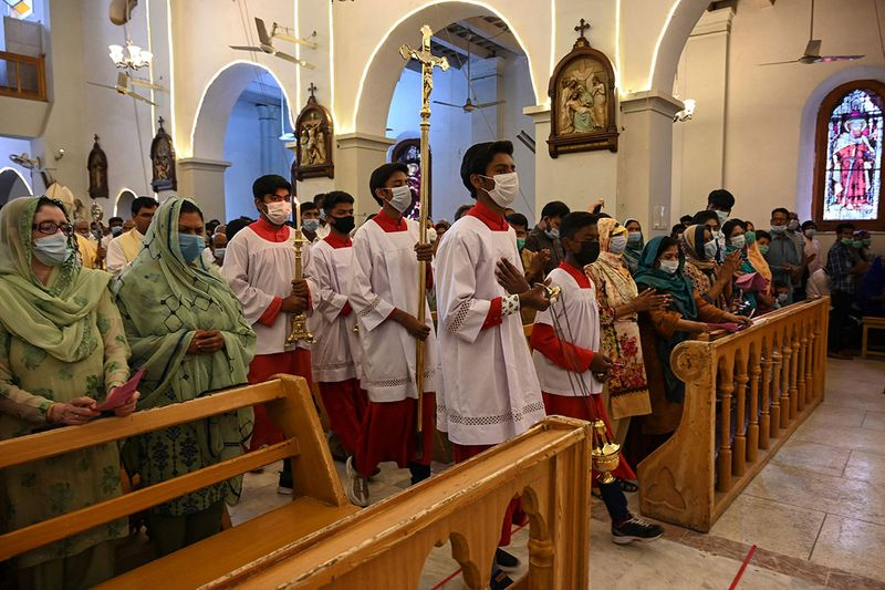 Christian devotees attend an Easter mass at the St Joseph's Catholic Cathedral in Rawalpindi on April 4, 2021.