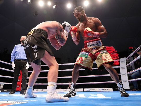 Jamel Herring of the United States, right, lands a blow on Carl Frampton in Dubai