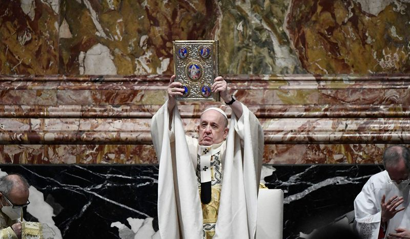 Pope Francis holds the Book of Gospels as he celebrates Easter Mass on April 04, 2021 at St. Peter's Basilica in The Vatican during the Covid-19 coronavirus pandemic.