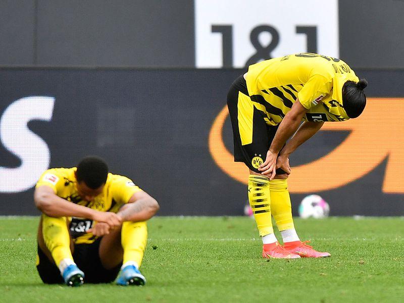 Dortmund's Emre Can and Manuel Akanji after the loss to Eintracht Frankfurt