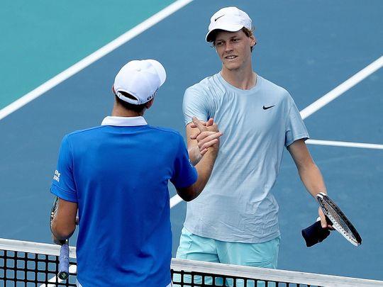 Hubert Hurkacz of Poland is congratulated by Jannik Sinner after the Miami Open final