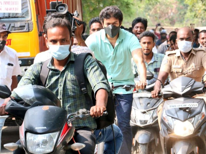 Indian actor Vijay riding a bicycle to a polling booth in Chennai