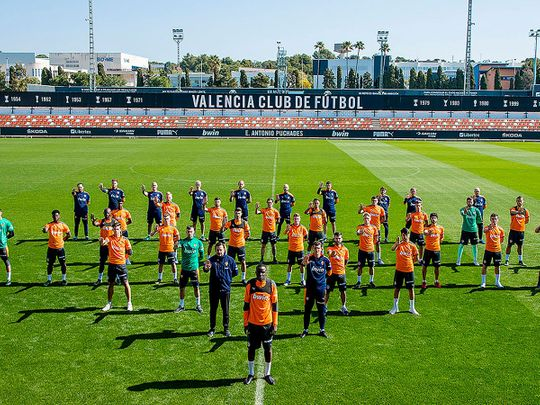 Valencia players and staff show their support to defender Mouctar Diakhaby as they protest against racism. Valencia's players walked off during their La Liga game with Cadiz on April 4 in protest against alleged racist abuse.