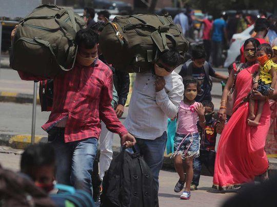 Passengers migrants Mumbai workers luggage