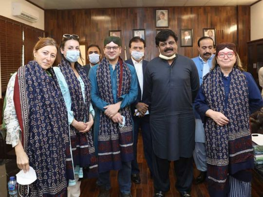 Italy archaeology delegation Ajrak shawl Sindh Culture and Antiquities Minister Syed Sardar Ali Shah