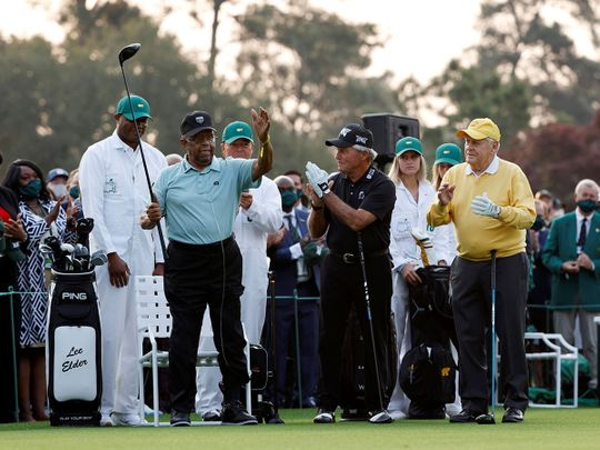 Lee Elder with Jack Nicklaus and Gary Player on the first tee at the Masters in Augusta
