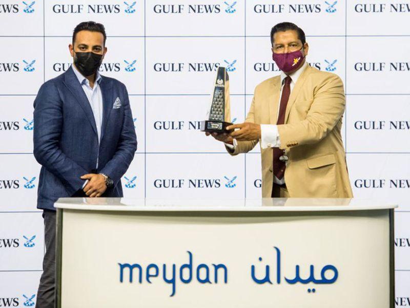 Rizvi Rias, Gulf News Online Sales Manager, with Satish Seemar