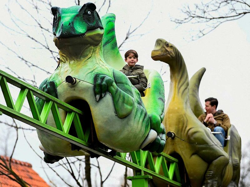 Photos: Roller-coaster rides for Dutch fans willing to get COVID-19 nose swab
