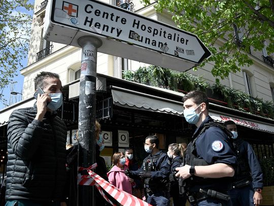 French police cordon off the area near the Henry Dunant private hospital where one person was shot dead and one injured in a shooting outside the instituion owned by the Red Cross in Paris' upmarket 16th district on April 12, 2021.