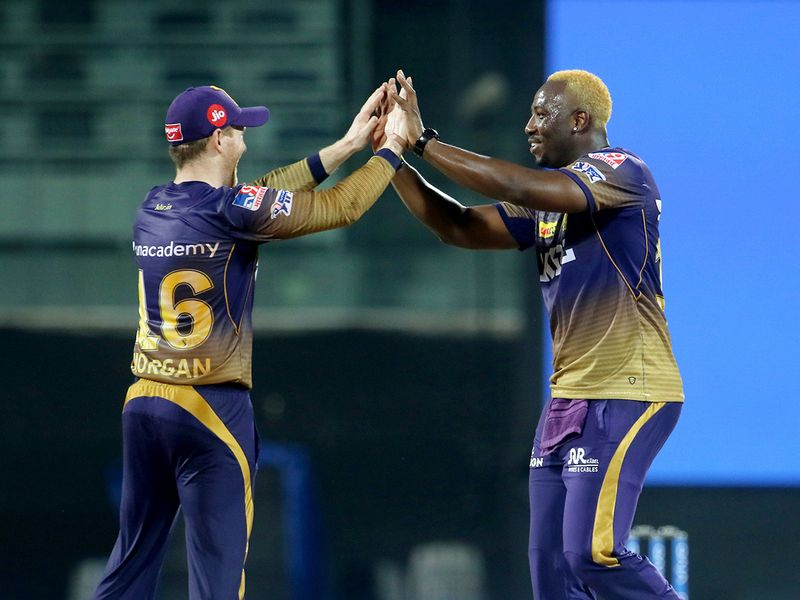 Andre Russell (right) and Eoin Morgan
