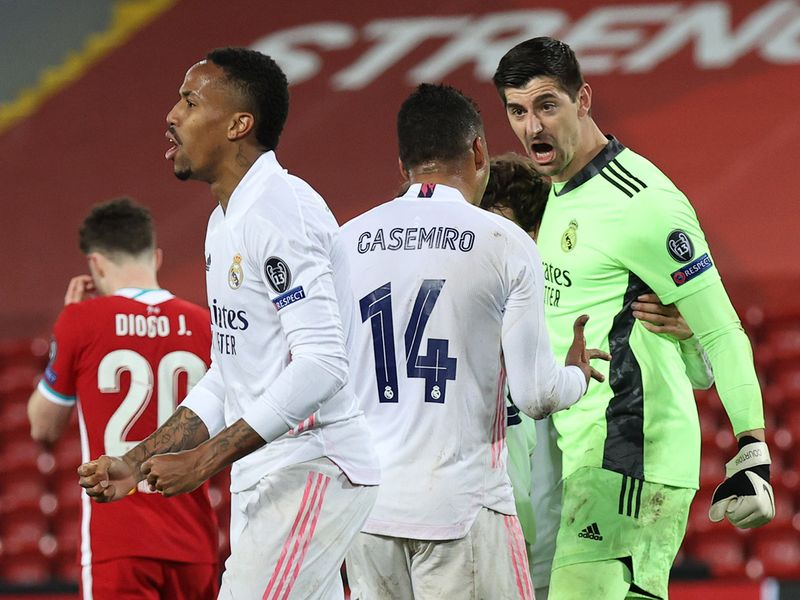 Champions League - Quarter Final Second Leg - Liverpool v Real Madrid - Anfield, Liverpool, Britain - April 14, 2021 Real Madrid's Thibaut Courtois celebrates with teammates after the match.