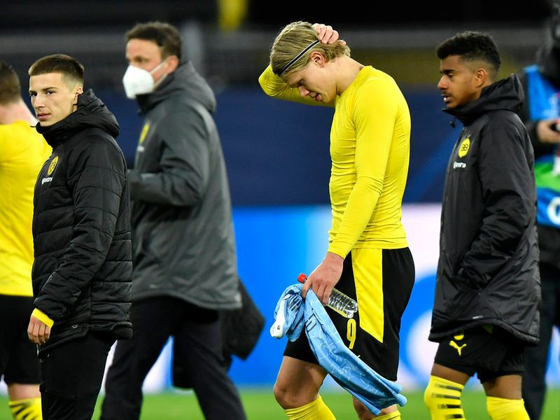 Dortmund's Erling Haaland is dejected after the Champions League quarterfinal second leg soccer match between Borussia Dortmund and Manchester City at the Signal Iduna Park stadium in Dortmund, Germany, Wednesday, April 14, 2021. (AP Photo/Martin Meissner, Pool)