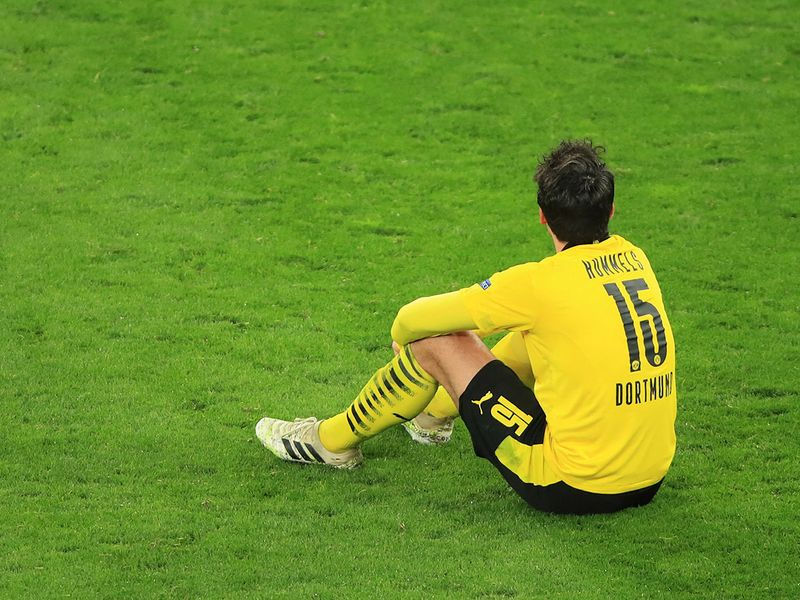 Dortmund's German defender Mats Hummels sits on the pitch after the UEFA Champions League quarter-final second leg football match between BVB Borussia Dortmund and Manchester City in Dortmund, western Germany, on April 14, 2021. (Photo by WOLFGANG RATTAY / POOL / AFP)