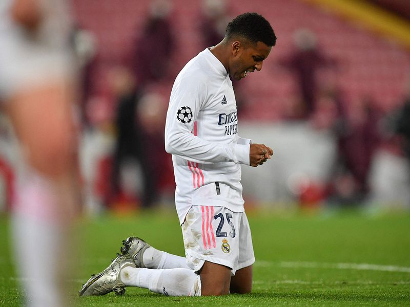 Real Madrid's Brazilian forward Rodrygo reacts at the final whistle during the UEFA Champions League quarter final second leg football match between Liverpool and Real Madrid at Anfield in Liverpool, north west England on April 14, 2021. (Photo by Paul ELLIS / AFP)
