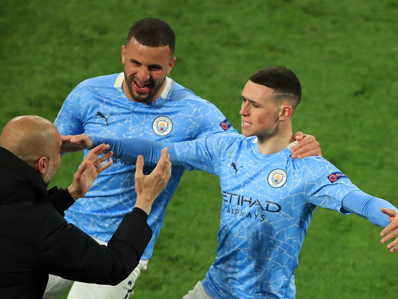Soccer Football - Champions League - Quarter Final Second Leg - Borussia Dortmund v Manchester City - Signal Iduna Park, Dortmund, Germany - April 14, 2021 Manchester City's Phil Foden celebrates scoring their second goal with manager Pep Guardiola and Kyle Walker Pool via REUTERS/Wolfgang Rattay