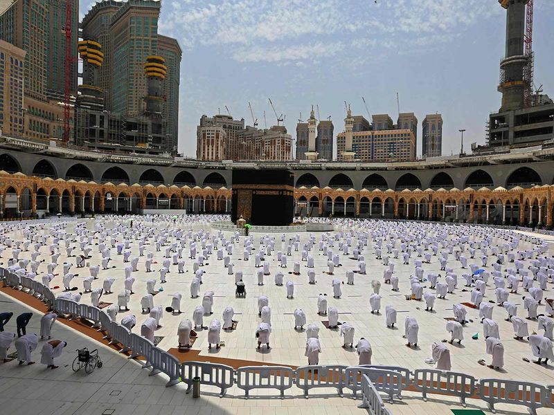Muslim worshipers pray around the Kaaba, the holiest shrine in the Grand mosque complex in the Saudi city of Mecca, during the Friday prayers of Ramadan, on April 16, 2021.