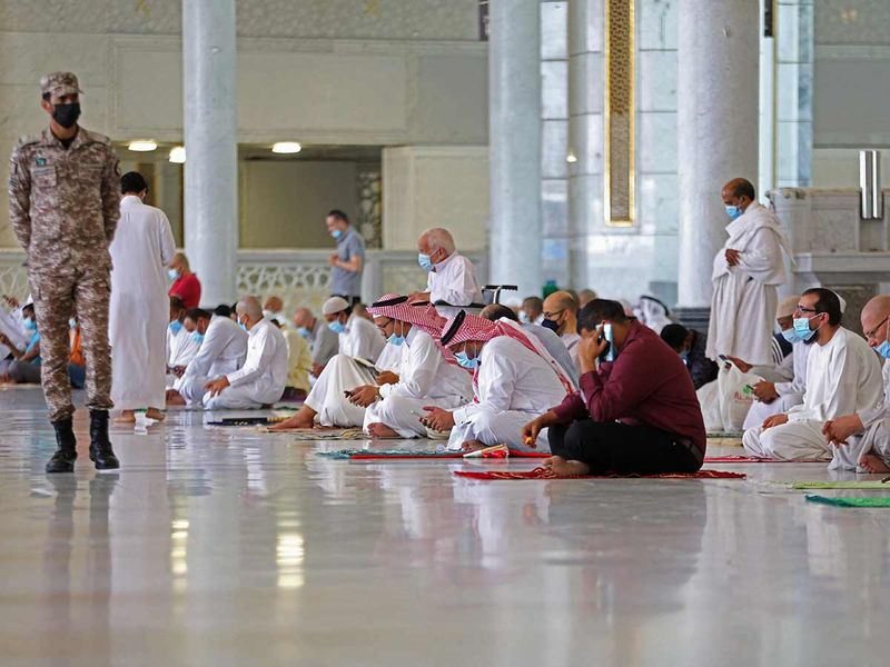 Worshippers pray inside the Grand Mosque in the Saudi holy city of Mecca, during the first Friday prayers of Ramadan, on April 16, 2021.