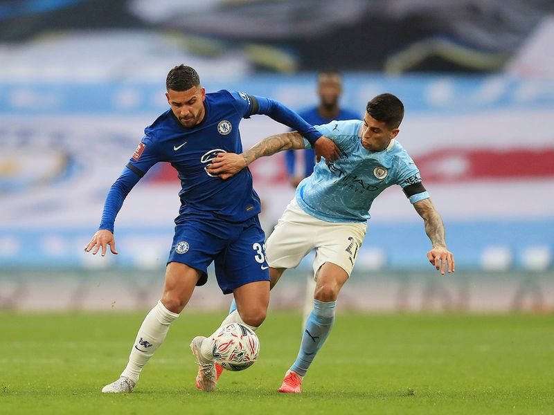 Chelsea's Emerson Palmieri, left, challenges for the ball with Manchester City's Joao Cancelo during the English FA Cup semifinal at Wembley Stadium.