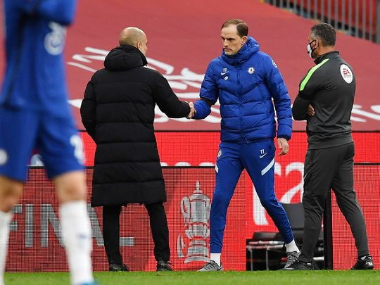 Manchester City's Pep Guardiola and Chelsea's Thomas Tuchel shake hands after the FA Cup semifinal.