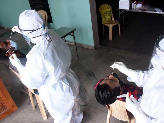 Kerala health workers nasal swab