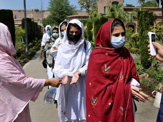Teacher children pakistan school temperature check