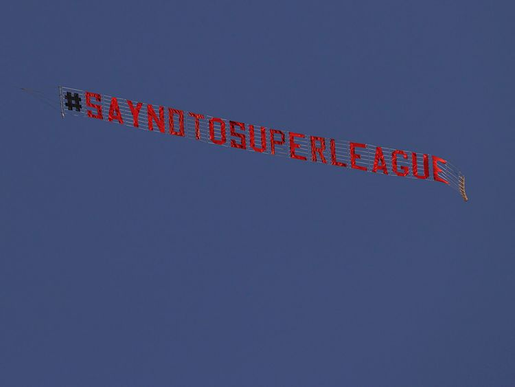 A plane, not seen, with a 'Say No To Super League' banner flies over ahead of the English Premier League match between Leeds United and Liverpool at the Elland Road stadium in Leeds.