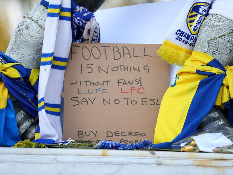 Close up of a banner as fans protest outside Elland Road against Liverpool's decision to be included amongst the clubs attempting to form a new European Super League.