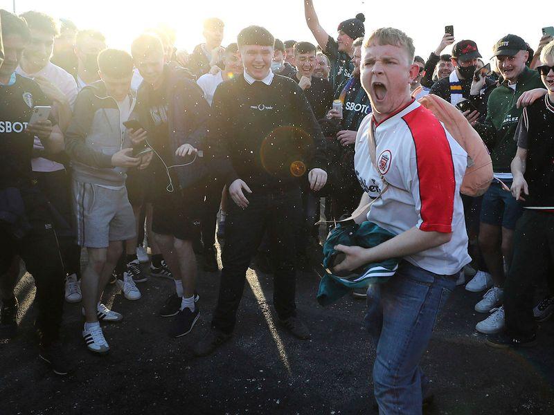 Football fans protest the European Super League.