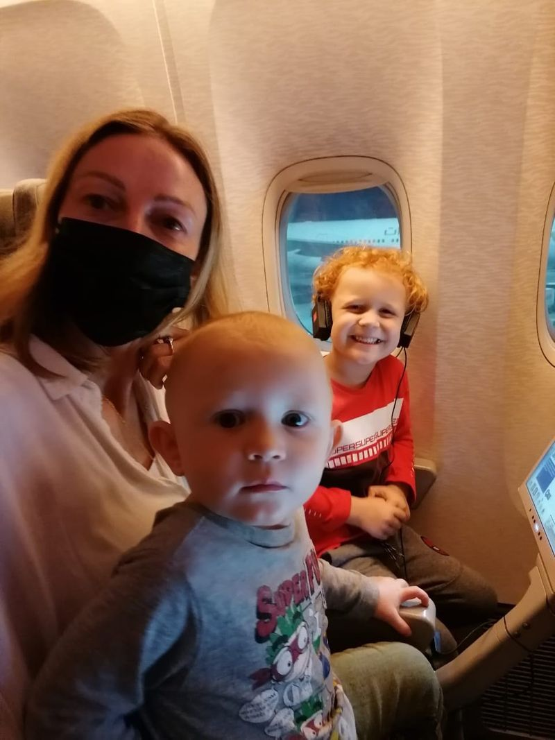 Yvonne Kerr and her children on the plane flying to the Maldives