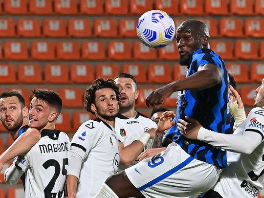Inter Milan's Belgian forward Romelu Lukaku goes for the ball against Spezia