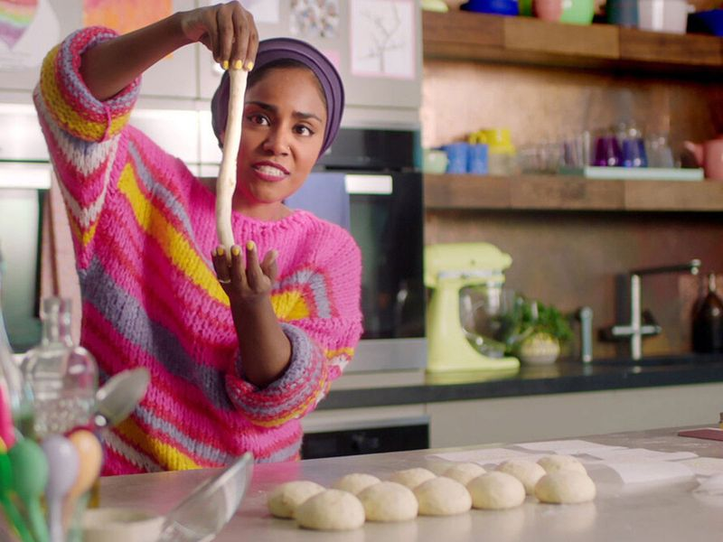 "Nadiya Hussain making onion pretzels on her Netflix cooking show ""Nadiya Bakes."""