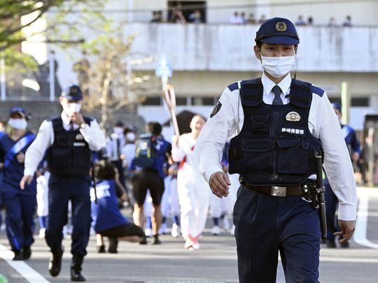 Police patrol the Tokyo 2020 Olympic Torch Relay