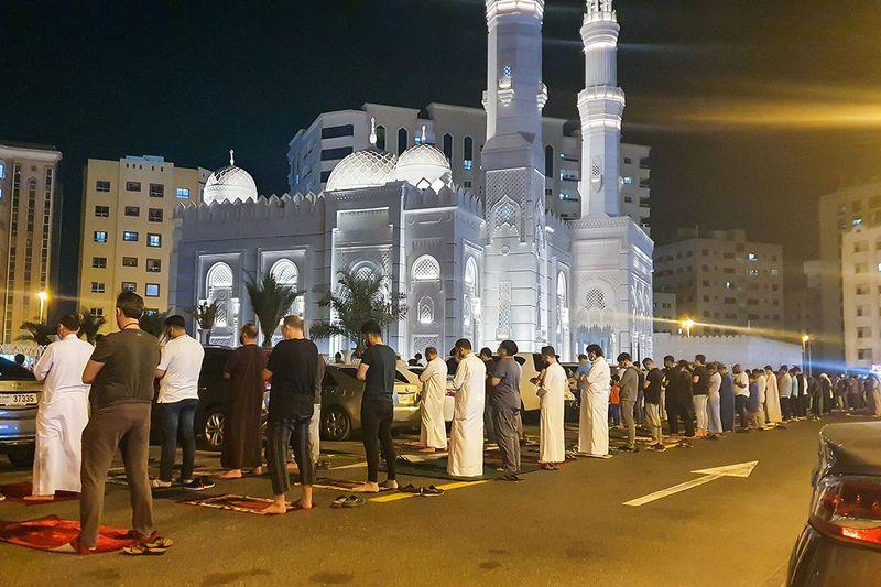 Residents offering Taraweeh prayer outside a mosque in Al Majaj, Sharjah.