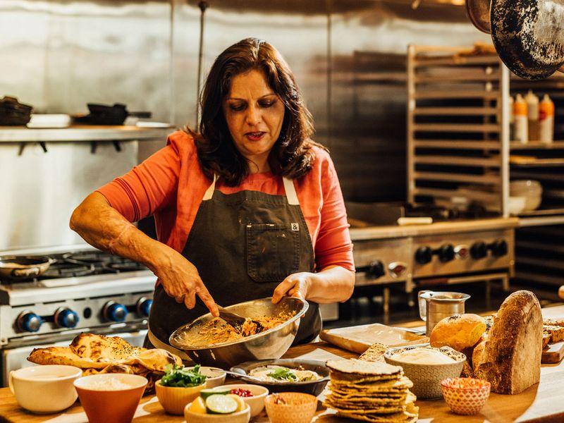 The chef and restaurateur Anita Jaisinghani makes carrot semolina bread at her restaurant, Pondicheri, in Houston