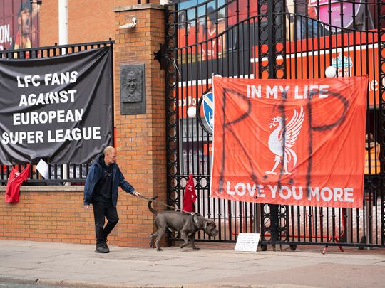 Banners are seen outside Liverpool's Anfield Stadium after the collapse of English involvement in the proposed European Super League
