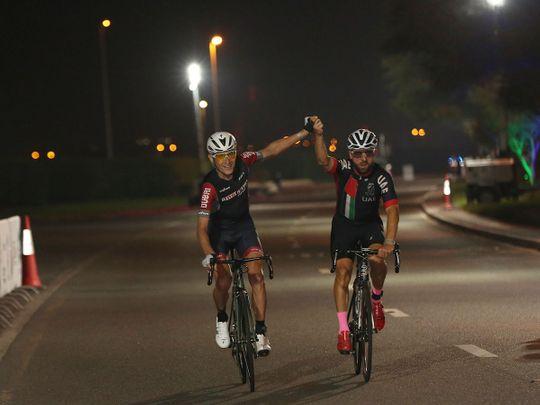 Jani Brajkovic wins the 75km Nad Al Sheba Cycling Championship alongside friend Vladimir Gusev