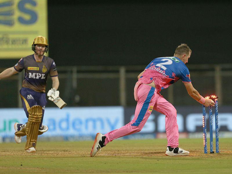 Chris Morris of Rajasthan Royals runs out Eoin Morgan