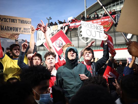 Fans protest against Arsenal owner Stan Kroenke ahead of the game against Everton