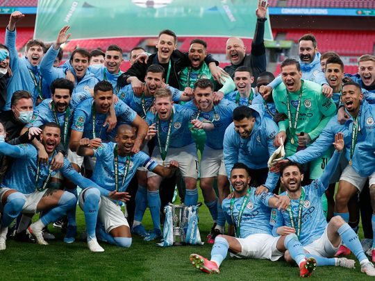 Manchester City celebrate four League Cups in a row