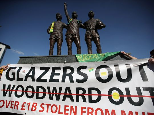 Manchester United fans protest against owners after failed launch of a European Super League at Old Trafford.