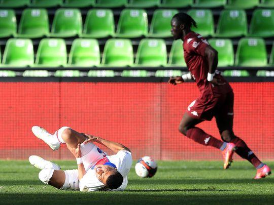Paris St-Germain's Kylian Mbappe goes down injured against MEtz