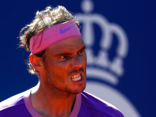 Rafael Nadal of Spain reacts after beating Pablo Carreno Busta in Barcelona