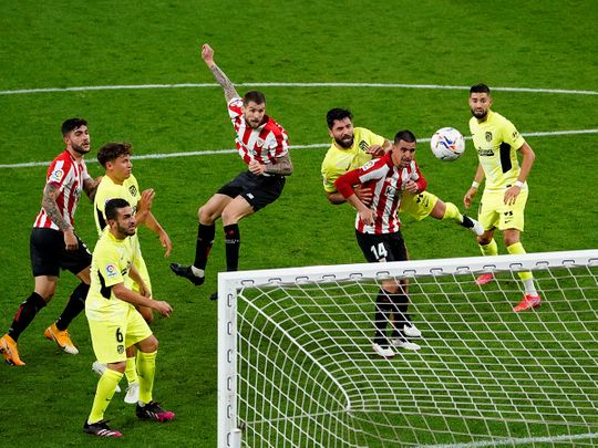 Athletic Bilbao's Inigo Martinez scores their second goal against Atletico Madrid.