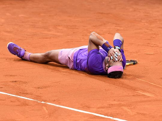 Rafael Nadal celebrates his 12th win at the Barcelona Open after outlasting Stefanos Tsitsipas.