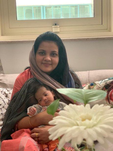 NAT 210421 Shahina with her newborn son, Rozain-1619500720910