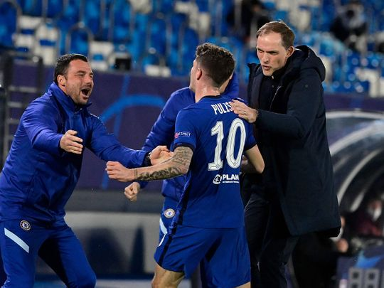 Pulisic is congratulated by Chelsea manager Tuchel for scoring against Real Madrid