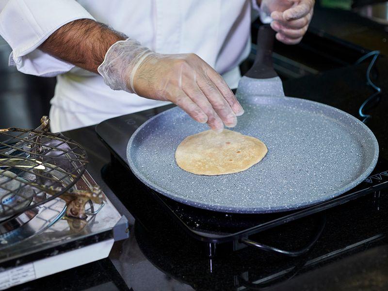 Step-10 Making phulka roti or whole-wheat flour puffed Indian bread