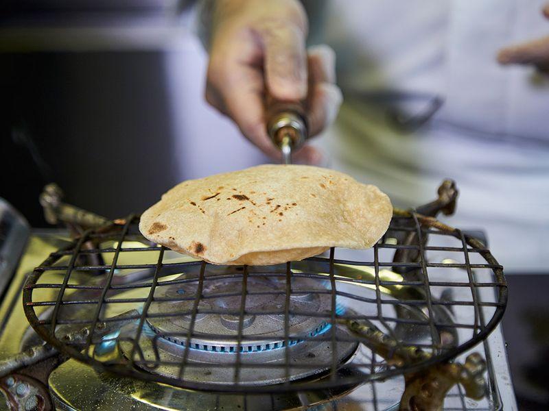 Step 13 - Making phulka roti or whole-wheat puffed Indian bread
