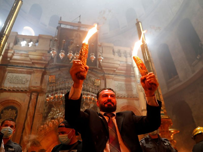 2021-05-01T110103Z_1502197054_RC2Z6N9QW4RG_RTRMADP_3_RELIGION-EASTER-ORTHODOX-HOLY-FIRE